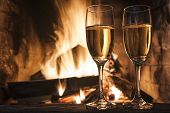 image of congrats  - glasses of champagne in front of fireplace - JPG