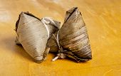 steamed sticky rice wrapped with banana leaf