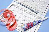 stock photo of hooters  - Party Favors and Calendar on Blue Background - JPG