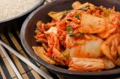 foto of kimchi  - A bowl of traditional Korean napa Kimchi with white rice - JPG