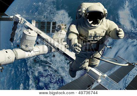 Постер, плакат: Астронавт на фоне планеты «Н ts стиле НАСА изображения», холст на подрамнике