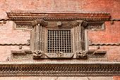 Carved wooden window on Hanuman Dhoka old Royal Palace Durbar Square in Kathmandu,  Nepal.