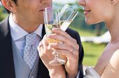 Closeup Of Bride And Groom Drinking Champagne Outdoor