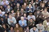 stock photo of cheer-up  - High angle view of multiethnic people clapping at rally - JPG