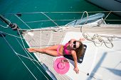 Young woman Sailing On Yacht in Lefkada Greece