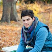 Young stylish man portrait, autumn outdoor.