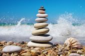 Stone pyramid on a seashore. Relax composition.