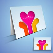 Happy Valentines Day greeting card or gift card with colorful hearts on blue background.