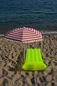 Airbed And Sun Umbrella On A Beach