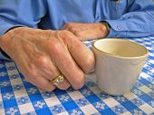 Elderly Hand With Coffee Cup