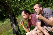 Two Men Relax With E-cigarette