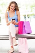 Shopping woman text messaging
