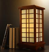 Japanese table lamp on brown background