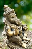 Ganesha Statue On Green Background