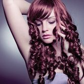 portrait of a girl with beautiful red curly hair