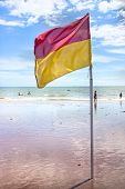 saety flag on uk beach allowing swimming