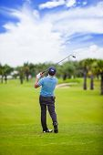 Male Golf Player Teeing Off Golf Ball