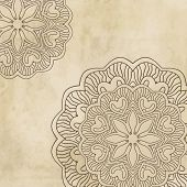 Vintage background with mandala ornament on grunge paper