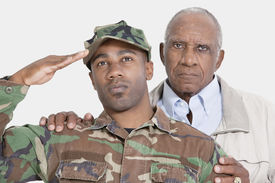 picture of united states marine corps  - Portrait of US Marine Corps soldier with father saluting over gray background - JPG