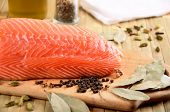 stock photo of redfish  - salmon fillet on a cutting board close - JPG
