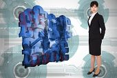 Serious businesswoman against technology wheel background