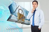 Thinking businessman touching his chin against abstract blue design in white room
