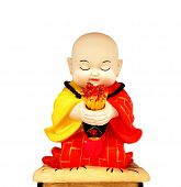 Ceramic Of Little Monk On White Background