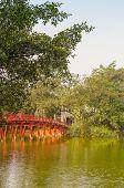 HANOI, VIETNAM, JANUARY 13, 2013 - Huc Bridge on Hoan Kiem Lake. The lake is one of the major scenic