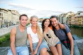 Friends - group of people on travel vacation having fun together. Two couples traveling in Florence,