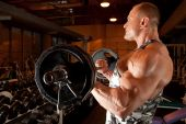 stock photo of body builder  - bodybuilder in modern training room with modern interior - JPG