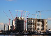 View Of Construction Area With Cranes Near Waterfront