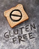 pic of fresh slice bread  - Gluten free bread with symbol and caption written in flour - JPG