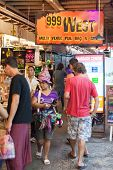 BANGKOK, THAILAND - JANUARY 9, 2012: Tourists visits Khao San Road Market. It has reached a landmark