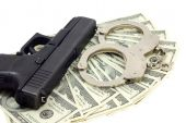 Black gun, bracelets and cash