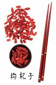 Wolfberry fruit chinese herbal medicine with chopsticks and mandarin script title translation. Gou q