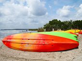 Colorful Kayaks On Beach