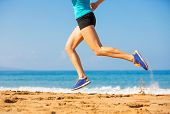 Woman running on the beach, fitness and heath care concept