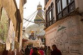 KHATMANDU, NEPAL - DEC 17: Unidentified Buddhist pilgrims near stupa Boudhanath during festive solem