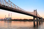 Queensboro Bridge over New York City East River at sunset viewed from midtown Manhattan.