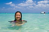 Girl Swimming In The Water At The Beach Of The Koh Ngai Island Thailand