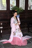 Young Woman Plays Flute In Suzhou, China