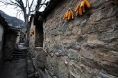 picture of hustle  - There is a small village deep in the Taihang Mountains in Shanxi Yue Zhai Feng quaint stone village where the road into town a stone house only the elderly and young children there is no hustle and bustle of the city but there are some fun