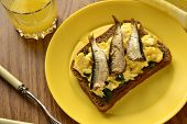 Breakfast - sandwich - scrambled eggs with sprats on rye bread