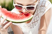 Girl In White Summer Dress Eat Watermelon