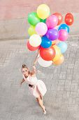 Beautiful Lady In Retro Outfit Holding A Bunch Of Balloons