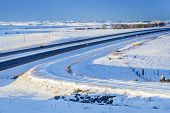 winter travel in Colorado - highway I-25 and a frontage road  at Natural Fort Near Wyoming border