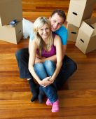 High Angle Of A Couple Sitting On Floor. Moving House