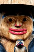 stock photo of totem pole  - Closeup of a North American Indian wooden totem pole - JPG