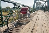 Tricycle On Old Bridge - Memorial Bridge In Pai