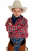 Adorable Young Cowboy Looking At Camera Arms Folded
